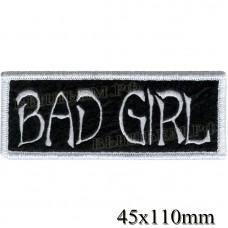 "Stripe ROCK paraphernalia ""Bad Girl"" white embroidery (option 2), serger, black background, Velcro or glue."