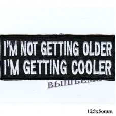 "Stripe ROCK paraphernalia ""I M NOT GETTING OLDER I M GETTING COOLER"" white embroidery, black background, Velcro or glue."
